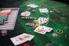 Classic blackjack game with chips and cards. Classic traditional blackjack game with chips and cards on the table Royalty Free Stock Images