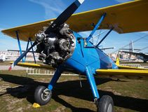 Classic blue biplane Royalty Free Stock Image