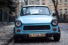 Classic Blue Car Parked Near Fence and Trees Royalty Free Stock Photography