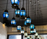 Classic blue glass ceiling lamps in the restaurent stock photos