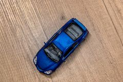 Classic blue model toy car. On wooden desk royalty free stock photo