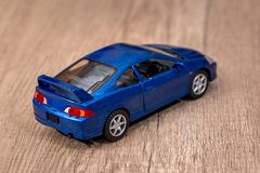 Classic blue model toy car. On wooden desk stock photo
