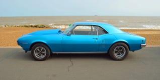 Classic Blue Pontiac Firebird motor car. FELIXSTOWE, SUFFOLK, ENGLAND - AUGUST 27, 2016: Classic Blue Pontiac Firebird motor car  parked on seafront promenade Stock Photo