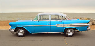 Classic Blue Pontiac Star Chief Motor Car  parked on seafront promenade. Royalty Free Stock Images
