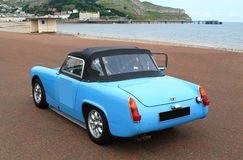 Classic blue stylish British sports car Royalty Free Stock Image