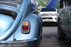 A classic, blue Volkswagen Beetle car stock image