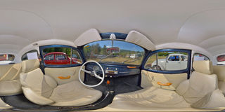 Classic Blue VW Beetle Interior at a Classic Car Show. 360 panorama of the interior of an classic blue Volkswagen Beetle vintage automobile at a classic car show Stock Images