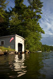 Classic boat house. Boat house on New Hampshire lake Stock Photo
