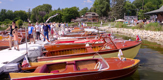 Classic Boat Show. A series of vintage wooden motor boats on display at a boat show Royalty Free Stock Images