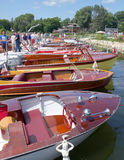 Classic Boat Show. A series of vintage wooden motor boats on display at a boat show Royalty Free Stock Photography