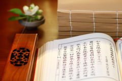 Classic books. The ancient classic books and Incense and flowers Stock Photo