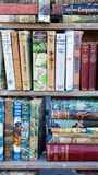 Classic Books. Assorted old and classic books on display at a book fair. Image taken on portrait view Royalty Free Stock Photography