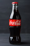 Classic bottle Of Coca-Cola on rustic background Royalty Free Stock Photography