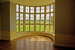 Classic bow window. A magnificent window in an empty mansion stock photography