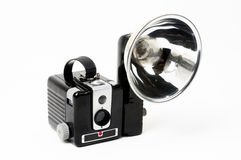 Classic Box Camera with Flash. A classic box camera with reflex viewfinder from the 1950s. Its matching flash attachment is attached complete with a flashbulb Stock Photography