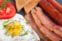 Classic breakfast with fried egg Stock Photos