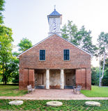 Classic brick church with benches in Alabama Stock Images