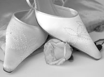 Classic Bridal Shoes. Elegant satin bridal shoes in monotone black and white to convey its timeless style and elegance Royalty Free Stock Images