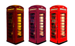 Classic British color phone booths in London UK, isolated on white Stock Photos