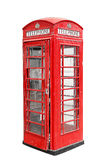 Classic British red phone booth in London UK, isolated on white. Background Royalty Free Stock Images