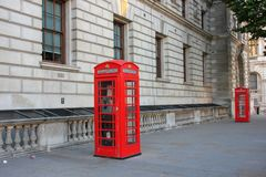 Classic british red phone booth  on old street of London, UK stock photo