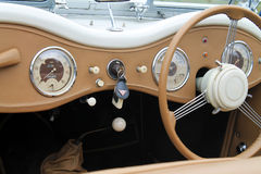 Classic british sporst car interior. 1950 alvis tb14 sports car interior dashboard and gauges Royalty Free Stock Photography