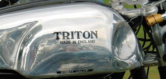 Classic British motorcycle metallic fuel tank. Classic British Triton motorcycle metallic fuel tank in profile and closeup Royalty Free Stock Image
