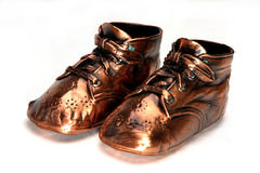 Classic Bronze Baby Shoes. Bronze baby shoes on white background Stock Photos