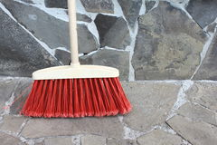 Classic broom closeup on a stone background Stock Photos