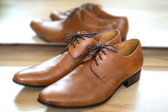 Classic brown lace up leather male dress shoes with mirror refle Stock Photography