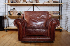 Classic Brown leather armchair in  library Stock Photography