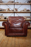 Classic Brown leather armchair in  library Stock Images