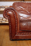 Classic Brown leather armchair in  library Stock Photo