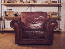 Classic Brown leather armchair in  library Royalty Free Stock Image