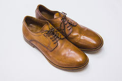 Classic brown leather male shoes. Over natural white background Royalty Free Stock Photo
