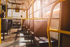 Classic brown leather seats in old city bus. Public transport Royalty Free Stock Photos