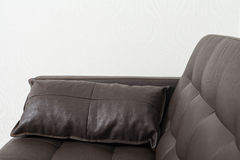 Classic brown leather sofa with pillow Stock Images