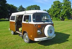 Classic Brown and White Volkswagen Car Parked on Village Green. Royalty Free Stock Photo