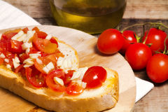 Classic bruschetta with garlic, oil and tomato Stock Photos