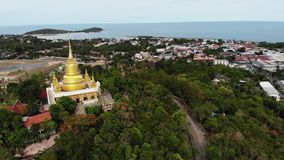 Classic Buddhist temple between forest. From above drone view Buddhist monastery between green trees near hill in. Thailand. Koh Samui. concept of tourism stock video