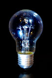Classic bulb. Classic electric bulb on black background. Old lightbulb Stock Images