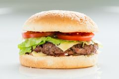 Classic burger, cheeseburger royalty free stock photography