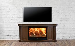 Classic burning fireplace with TV in bright empty living room interior of house.  royalty free stock photos