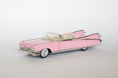 Classic Cadillac Eldorado. Classic American car: Cadillac Eldorado in pink, on white background stock images