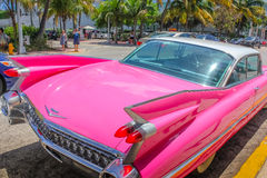 Classic Cadillac Eldorado. Miami, Florida, United States - April 8, 2012: from behind of the luxurious vintage pink Cadillac Eldorado on a street near Ocean Stock Photography