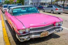 Classic Cadillac Eldorado. Miami, Florida, United States - April 8, 2012: front of the luxurious vintage pink Cadillac Eldorado on a street near Ocean Drive in royalty free stock image