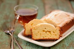 Classic cake of cup of tea on old painted planks Stock Photography