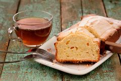 Classic cake of cup of tea on old painted planks Royalty Free Stock Photo