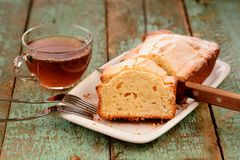 Classic cake and cup of tea on old painted planks Royalty Free Stock Photos
