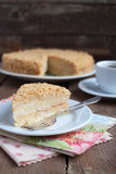 Classic Cake Napoleon of puff pastry with custard cream on a pla Stock Photo